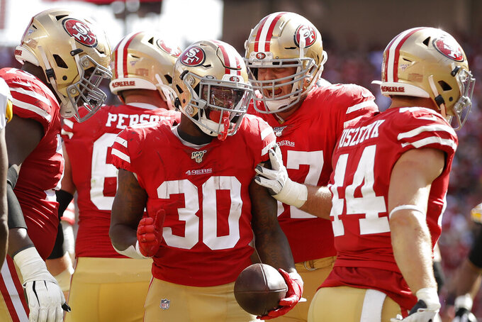 San Francisco 49ers running back Jeff Wilson Jr. (30) celebrates with teammates after scoring against the Pittsburgh Steelers during the second half of an NFL football game in Santa Clara, Calif., Sunday, Sept. 22, 2019. (AP Photo/Ben Margot)