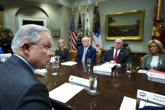 FILE - In this Tuesday, March 20, 2018 file photo, Attorney General Jeff Sessions, left, speaks during a roundtable talks on sanctuary cities hosted by President Donald Trump, third from right, in the Roosevelt Room of the White House, in Washington. The Trump administration can withhold millions of dollars in law enforcement grants to force states to cooperate with U.S. immigration enforcement, a federal appeals court in New York ruled Wednesday, Feb. 26, 2020 in a decision that conflicted with three other federal appeals courts. (AP Photo/Manuel Balce Ceneta)