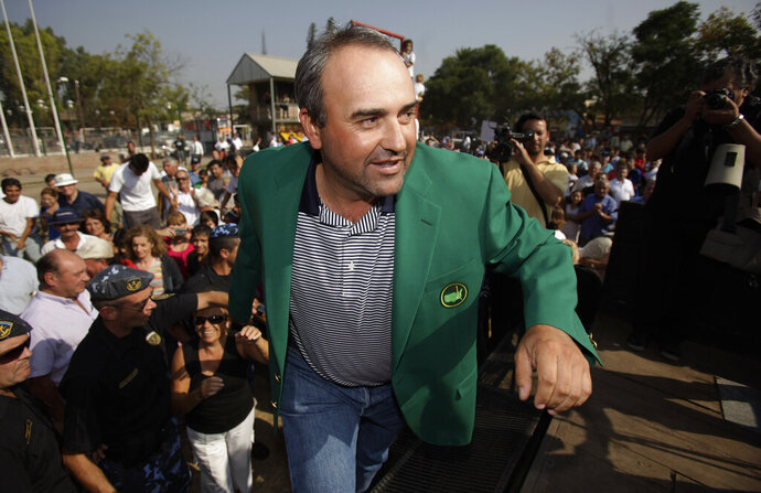 FILE - In this April 14, 2009 file photo, Argentina's golfer Angel Cabrera arrives to his hometown Villa Allende in Argentina. Two federal police officers in Brazil said that Cabrera has been arrested on Thursday, Jan. 14, 2021, for extradition to his homeland to face charges for several crimes allegedly committed from 2016 to last year.(AP Photo/Natacha Pisarenko, File)