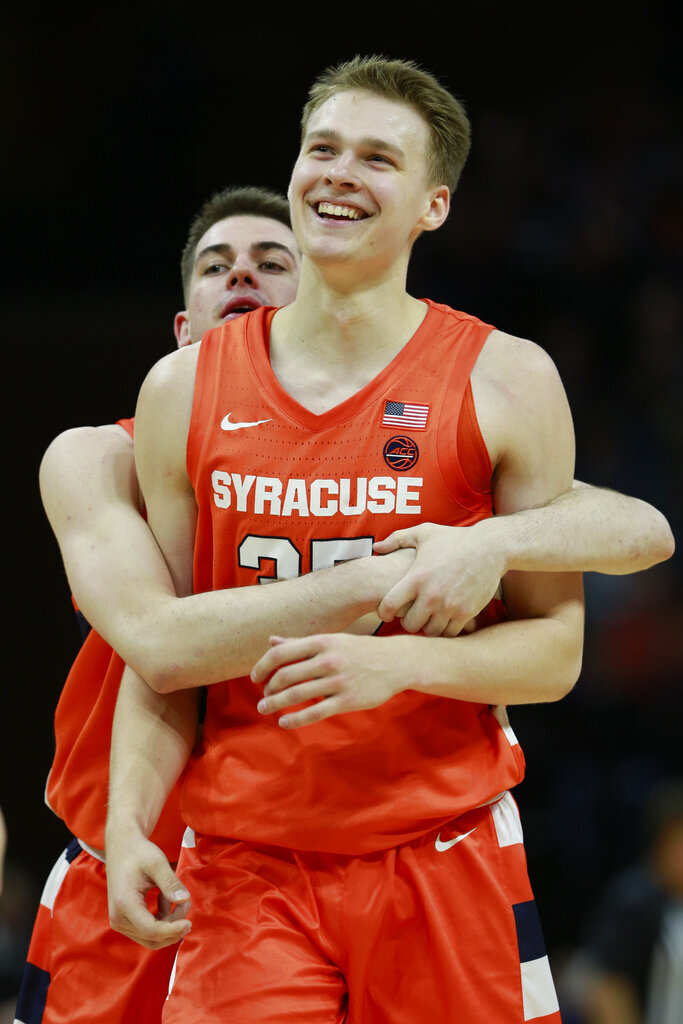 Syracuse guard Buddy Boeheim (35) celebrates a three point basket along with teammate Syracuse guard Joseph Girard III, left, during the second half of an NCAA college basketball game in Charlottesville, Va., Saturday, Jan. 11, 2020. Syracuse defeated Virginia 63-55. (AP Photo/Steve Helber)