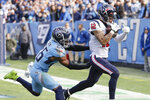 Houston Texans wide receiver Kenny Stills (12) catches a 12-yard pass for a touchdown as he is defended by Tennessee Titans cornerback Logan Ryan (26) in the first half of an NFL football game Sunday, Dec. 15, 2019, in Nashville, Tenn. (AP Photo/James Kenney)