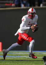 New Mexico quarterback Sheriron Jones (4) rolls out against Air Force during the first half of an NCAA college football game, Saturday, Nov. 10, 2018, at Air Force Academy, Colo. (AP Photo/Jack Dempsey)