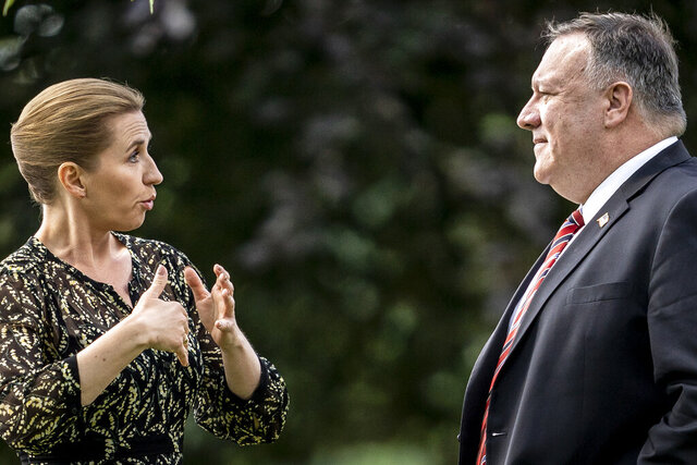 FILE - In this July 22, 2020 file photo Secretary of State Mike Pompeo, right, speaks with Danish Prime Minister Mette Frederiksen in the garden of Marienborg Castle north of Copenhagen. The Trump administration has appointed a new special envoy for the Arctic. The appointment of career diplomat Jim DeHart to the job of U.S. coordinator for the Arctic fills a post that was vacant for more than three years as the administration seeks a greater role in the region and tries to blunt growing Russian and Chinese influence there. The State Department announced the move Wednesday, a week after Secretary of State Mike Pompeo vowed enhanced U.S. engagement in the Arctic on a visit to Denmark. (Mads Claus Rasmussen/Pool Photo via AP)