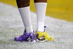 Kansas City Chiefs' Demarcus Robinson wears cleats honoring Kobe Bryant before the NFL Super Bowl 54 football game between the San Francisco 49ers and Kansas City Chiefs Sunday, Feb. 2, 2020, in Miami Gardens, Fla. (AP Photo/Seth Wenig)