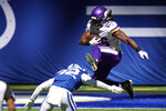 Minnesota Vikings' Alexander Mattison (25) leaps over Indianapolis Colts' Julian Blackmon (32) during the first half of an NFL football game, Sunday, Sept. 20, 2020, in Indianapolis. (AP Photo/AJ Mast)