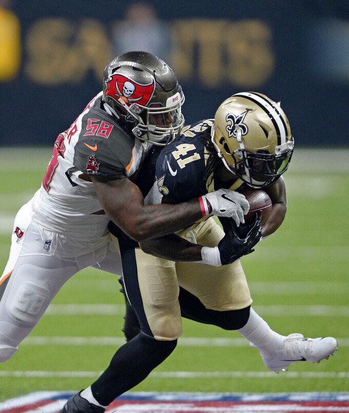 FILE - In this Sept. 9, 2018, file photo, Tampa Bay Buccaneers outside linebacker Kwon Alexander (58) tackles New Orleans Saints running back Alvin Kamara (41) in the first half of an NFL football game, in New Orleans. The San Francisco 49ers have agreed to sign linebacker Kwon Alexander to a four-year contract worth $54 million. A person familiar with the contract said the sides came to an agreement Monday, March 11, 2019, soon after teams were allowed to contact pending unrestricted free agents. The person spoke on condition of anonymity because the deal can't be finalized until the new league year starts Wednesday. (AP Photo/Bill Feig, File)