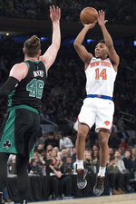 New York Knicks guard Allonzo Trier (14) shoots a 3-point goal past Boston Celtics center Aron Baynes (46) during the first half of an NBA basketball game Friday, Feb. 1, 2019, at Madison Square Garden in New York. (AP Photo/Mary Altaffer)