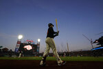 San Francisco Giants' Buster Posey walks to the on-deck circle during the sixth inning of a baseball game against the Pittsburgh Pirates in San Francisco, Saturday, July 24, 2021. (AP Photo/Jeff Chiu)