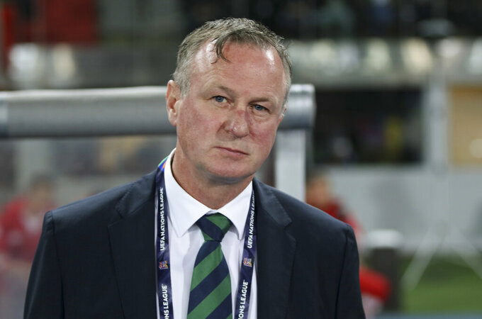 FILE - In this Friday, Oct. 12, 2018 file photo, Northern Ireland coach Michael O'Neill stands prior to the start of the UEFA Nations League soccer match between Austria and Northern Ireland at Ernst Happel stadium in Vienna, Austria. Northern Ireland coach Michael O'Neill left the job on Wednesday April 22, 2020, citing uncertainty over the team's European Championship playoffs due to the coronavirus pandemic. (AP Photo/Ronald Zak, File)