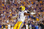 LSU wide receiver Ja'Marr Chase (1) celebrates his touchdown reception during the first half of the team's NCAA college football game against Texas A&M in Baton Rouge, La., Saturday, Nov. 30, 2019. (AP Photo/Gerald Herbert)