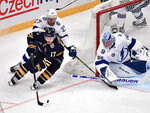Buffalo Sabres' Vladimir Sobotka (17) works the puck as Tampa Bay Lightning's Ryan McDonagh (27) and goalie Andrei Vasilevskiy defend during an NHL hockey game in Globen Arena, Stockholm Sweden. Friday. Nov. 8, 2019. (Anders Wiklund/TT via AP)