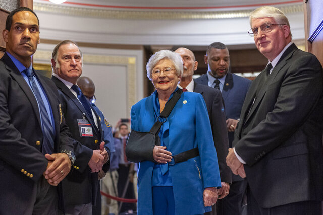 Gov. Kay Ivey, center, is introduced and invited into the chamber to give the State of the State Address to a joint session of the Alabama Legislature on Tuesday, Feb. 4, 2020, in the old house chamber of the Alabama State Capitol in Montgomery, Ala. (AP Photo/Vasha Hunt)