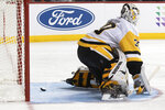 Pittsburgh Penguins goaltender Matt Murray gives up a goal to New York Islanders' Ryan Pulock during the second period of an NHL hockey game, Thursday, Nov. 7, 2019, in New York. (AP Photo/Mary Altaffer)