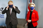 Britain's Prime Minister Boris Johnson meets with European Commission President Ursula von der Leyen during the G7 summit in Cornwall, England, Saturday June 12, 2021. (Peter Nicholls/Pool via AP)
