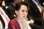 FILE - In this Nov. 3, 2019, file photo, Myanmar's leader Aung San Suu Kyi participates in ASEAN-U.N. summit in Nonthaburi, Thailand. Myanmar's government announced Wednesday, Nov. 20, 2019 that its leader Suu Kyi, will head a legal team it will send to the International Court of Justice in the Netherlands to contest a case of genocide filed against it by Gambia on behalf of the Organization of Islamic Cooperation. (AP Photo/Wason Wanichakorn)