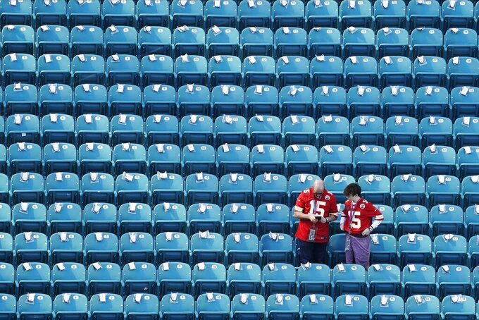 Fans look search for their seats before the NFL Super Bowl 54 football game between the San Francisco 49ers and Kansas City Chiefs Sunday, Feb. 2, 2020, in Miami Gardens, Fla. (AP Photo/Morry Gash)
