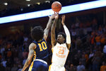 Tennessee guard Jordan Bowden (23) shoots as Murray State guard Tevin Brown (10) defends during an NCAA college basketball game Tuesday, Nov. 12, 2019, in Knoxville, Tenn. (Saul Young/Knoxville News Sentinel via AP)