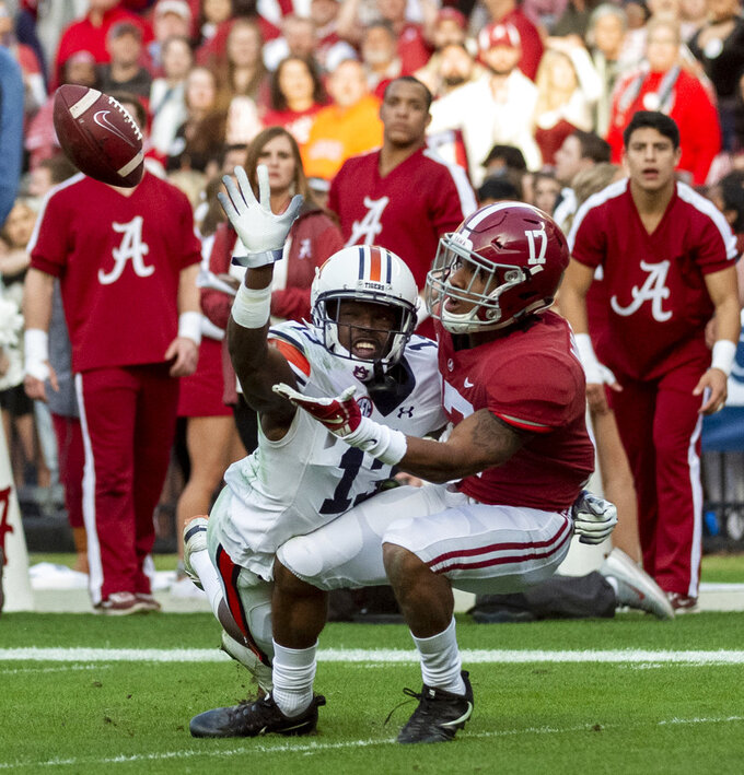 Auburn defensive back Javaris Davis (13) defends against Alabama wide receiver Jaylen Waddle (17) on a pass play during the first half of an NCAA college football game, Saturday, Nov. 24, 2018, in Tuscaloosa, Ala. (AP Photo/Vasha Hunt)