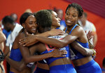 Phillis Francis, Sydney McLaughlin, Dalilah Muhammad and Wadeline Jonathas of the United States 4x100 meter relay team celebrate after their gold medal victory at the World Athletics Championships in Doha, Qatar, Sunday, Oct. 6, 2019. (AP Photo/David J. Phillip)