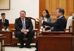 U.S. Secretary of State Mike Pompeo, left, is gestured by South Korean President Moon Jae-in, right, during a bilateral meeting at the presidential Blue House in Seoul, South Korea Thursday, June 14, 2018. (Kim Hong-ji/Pool Photo via AP)