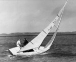 FILE - In this April 25, 1959 file photo, Britain's Prince Philip mans the tiller of the star class sailboat Gem IV, with Durward Knowles, right, as crew. After following the race Prince Philip made the cup presentation of the King's cup at the Nassau Yacht Club in Md.. (AP Photo/Harold Valentine, File)