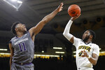 Iowa guard Isaiah Moss shoots over Northwestern guard Anthony Gaines, left, during the second half of an NCAA college basketball game, Sunday, Feb. 10, 2019, in Iowa City, Iowa. Iowa won 80-79. (AP Photo/Charlie Neibergall)