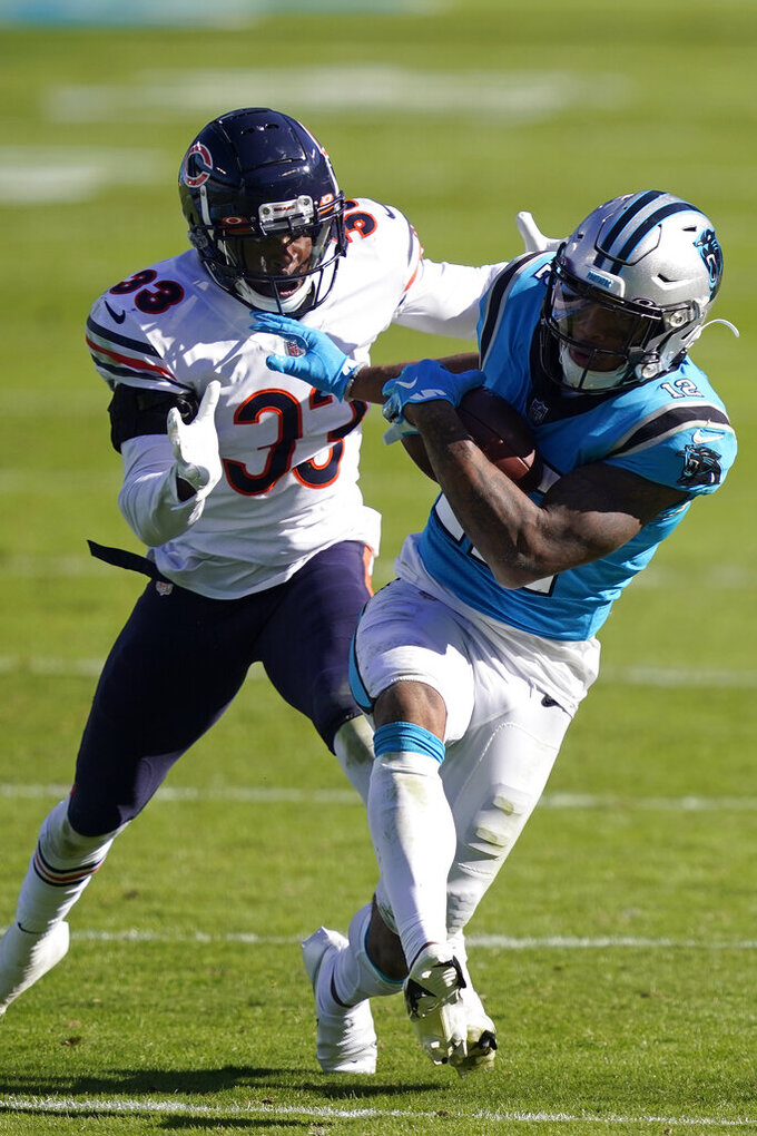 Chicago Bears cornerback Jaylon Johnson (33) chases Carolina Panthers wide receiver D.J. Moore (12) during the second half of an NFL football game in Charlotte, N.C., Sunday, Oct. 18, 2020. (AP Photo/Brian Blanco)