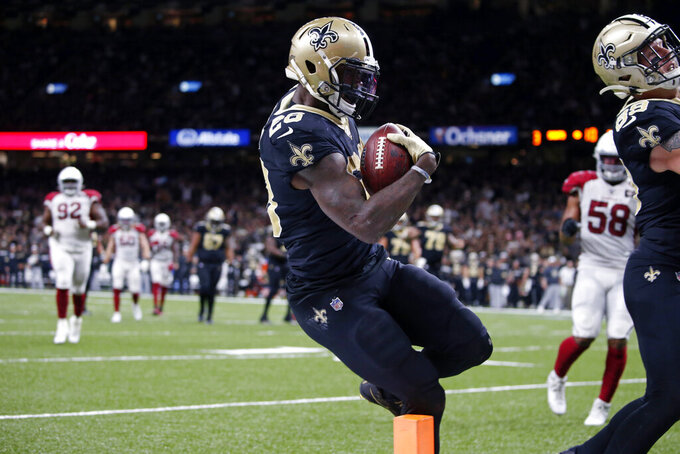 New Orleans Saints running back Latavius Murray (28) carries for a touchdown in the second half of an NFL football game against the Arizona Cardinals in New Orleans, Sunday, Oct. 27, 2019. (AP Photo/Butch Dill)