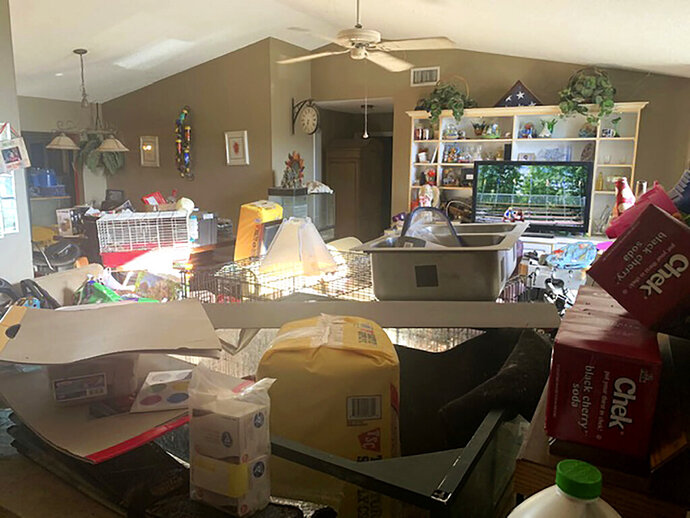 This Sunday, Oct. 20, 2019 photo made available by the Edgewater Police Department shows the interior of a home in Edgewater, Fla., where police found three children living with three adults and animals of various species in deplorable conditions.  (Edgewater Police Department via AP)