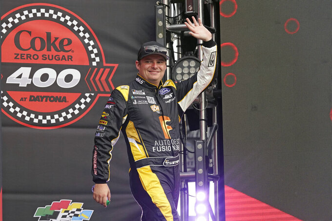 Cole Custer waves to fans during driver introductions before the NASCAR Cup Series auto race at Daytona International Speedway, Saturday, Aug. 28, 2021, in Daytona Beach, Fla. (AP Photo/John Raoux)