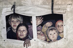 FILE- In this March 20, 1993, file picture evacuees form Srebrenica look out from a U.N. truck in Medgas, Bosnia, north of Sarajevo, as a U.N. truck convoy carrying people from the besieged Bosnian town made its way to Tuzla.  Survivors of the genocide in the eastern Bosnian town of Srebrenica, mainly women, will on Saturday July 11, 2020, commemorate the 25th anniversary of the slaughter of their fathers and brothers, husbands and sons.  At least 8,000 mostly Muslim men and boys were chased through woods in and around Srebrenica by Serb troops in what is considered the worst carnage of civilians in Europe since World War II. The slaughter was also the only atrocity of the brutal war that has been confirmed an act of genocide.(AP Photo/Michel Euler, File)