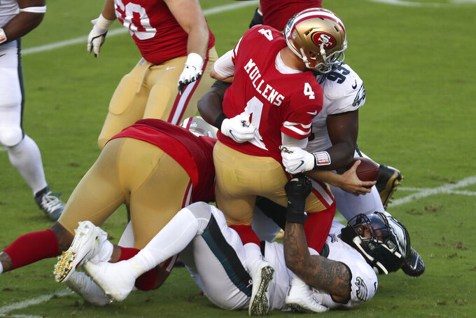 San Francisco 49ers quarterback Nick Mullens (4) is sacked by Philadelphia Eagles nose tackle Javon Hargrave (93) and Derek Barnett during the first half of during the first half of an NFL football game in Santa Clara, Calif., Sunday, Oct. 4, 2020. (AP Photo/Jed Jacobsohn)