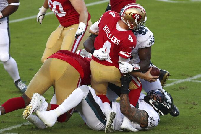 San Francisco 49ers quarterback Nick Mullens (4) is sacked by Philadelphia Eagles nose tackle Javon Hargrave (93) and Derek Barnett during the first half of during the first half of an NFL football game in Santa Clara, Calif., Sunday, Oct. 4, 2020. (AP Photo/Jed Jacobsohn)