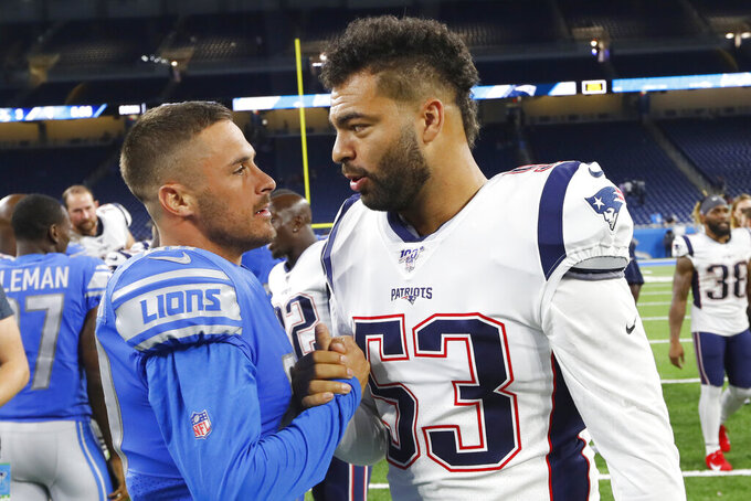 Detroit Lions wide receiver Danny Amendola, left, greets New England Patriots middle linebacker Kyle Van Noy, a former teammate, after a preseason NFL football game Thursday, Aug. 8, 2019, in Detroit. (AP Photo/Paul Sancya)