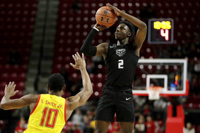 Oakland guard Tray Maddox Jr. (2) shoots over Maryland guard Serrel Smith Jr. (10) during the first half of an NCAA college basketball game, Saturday, Nov. 16, 2019, in College Park, Md. (AP Photo/Julio Cortez)