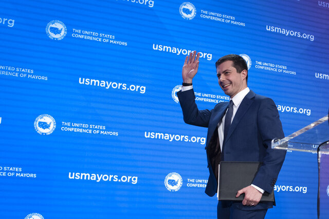 Democratic presidential candidate former South Bend, Ind., Mayor Pete Buttigieg, walks off stage after speaking at the ​U.S. Conference of Mayors' Winter Meeting, Thursday, Jan. 23, 2020, in Washington. (AP Photo/Cliff Owen)