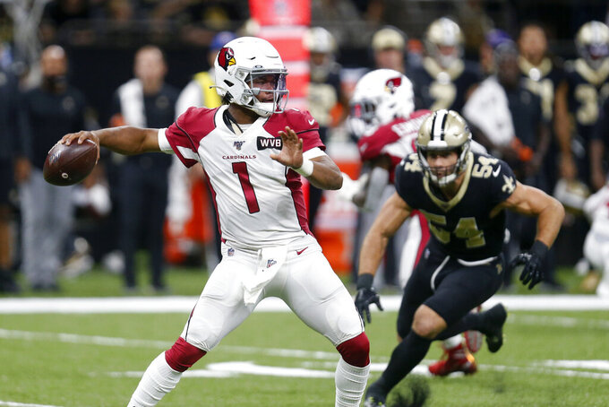 Arizona Cardinals quarterback Kyler Murray (1) passes as New Orleans Saints outside linebacker Kiko Alonso (54) pursues in the first half of an NFL football game in New Orleans, Sunday, Oct. 27, 2019. (AP Photo/Butch Dill)