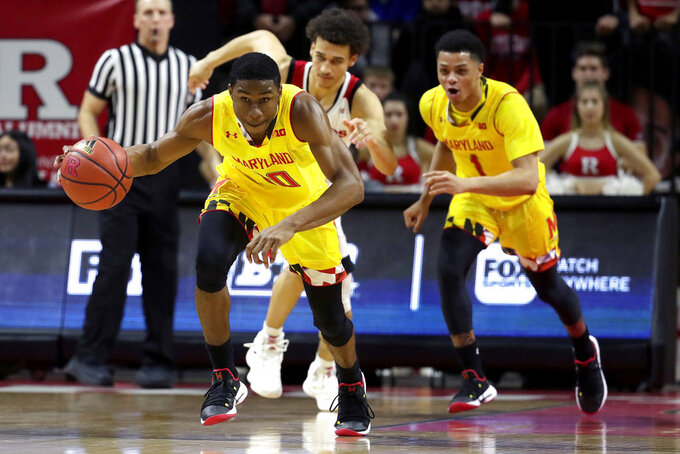 Maryland guard Serrel Smith Jr. drives after a turnover from Rutgers during the first half of an NCAA college basketball game, Saturday, Jan. 5, 2019, in Piscataway, N.J. Maryland won 77-63. (AP Photo/Julio Cortez)