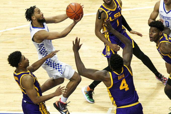 Kentucky's Davion Mintz, top left, shoots as LSU's Cameron Thomas, left, and Darius Days (4) defend during the second half of an NCAA college basketball game in Lexington, Ky., Saturday, Jan. 23, 2021. (AP Photo/James Crisp)