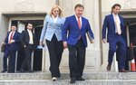 Patricia McCloskey, left, and her husband Mark McCloskey walk out of the Carnahan Courthouse in downtown St. Louis on Thursday, June 17, 2021, with their lawyer Joel Schwartz, right. The St. Louis couple who gained notoriety for pointing guns at social justice demonstrators last year pleaded guilty Thursday to misdemeanor charges and agreed to give up the weapons they used during the confrontation. (Joel Currier/St. Louis Post-Dispatch via AP)