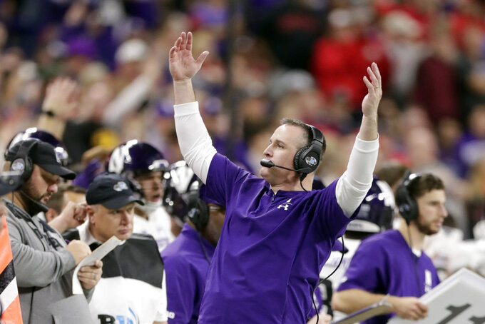 Northwestern head coach Pat Fitzgerald raises his arms on the sideline during the second half of the Big Ten championship NCAA college football game against Ohio State, Saturday, Dec. 1, 2018, in Indianapolis. (AP Photo/Michael Conroy)