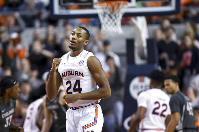Auburn forward Anfernee McLemore (24) celebrates a 3-point basket against Iowa State during the first half of an NCAA college basketball game Saturday, Jan. 25, 2020, in Auburn, Ala. (AP Photo/Julie Bennett)