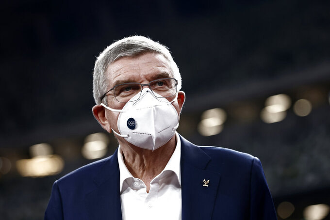 FILE - In this Nov. 17, 2020, file photo, IOC President Thomas Bach visits the National Stadium, the main venue for the 2020 Olympic and Paralympic Games postponed until July 2021 due to the coronavirus pandemic, in Tokyo. Bach has canceled a trip in May 2021 to Japan because of surging cases of COVID-19 in the country, the Tokyo Olympic organizing committee said Monday, May 10, 2021 in a statement. The trip was made impossible because of a state of emergency in Tokyo and other parts of the country that has been extended until May 31. (Behrouz Mehri/Pool Photo via AP, Fo;e)