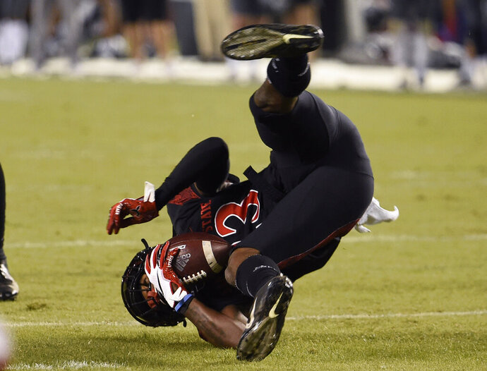 San Diego State cornerback Darren Hall (23) flips as he intercepts a pass during the first half of a college football game against Nevada Saturday, Nov. 9, 2019, in San Diego. CA. (AP Photo/Denis Poroy)