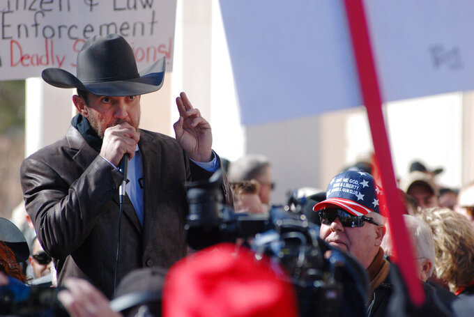 FILE - In this Friday, Jan. 31, 2020 file photo, Otero County Commissioner Couy Griffin speaks in Santa Fe, N.M., during a gun rights rally. A state district court judge says an effort can move ahead to try and recall Griffin, the Cowboys for Trump founder from his seat as an Otero County commissioner on accusations of using his public office for personal gain. District Court Judge Manuel Arrieta on Thursday, April 8, 2021, ruled in favor of a group of recall petitioners who say that Griffin had repeatedly abused his authority and should be subject to a recall election this year. (AP Photo/Morgan Lee, File)
