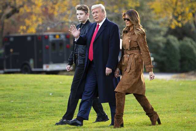 FILE - In this Tuesday, Nov. 26, 2019 file photo, President Donald, first lady Melania Trump, and Barron Trump, walk to board Marine One on the South Lawn of the White House in Washington. President Donald Trump insists that schools reopen so students can go back to their classrooms, but the Maryland private school where his son Barron is enrolled is among those under county orders to stay closed. (AP Photo/ Evan Vucci, File)