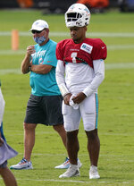 Miami Dolphins quarterback Tua Tagovailoa (1) and offensive coordinator Chan Gailey, left, stand on the field during practice at the NFL football team's training facility, Tuesday, Aug. 25, 2020, in Davie, Fla. (AP Photo/Lynne Sladky)