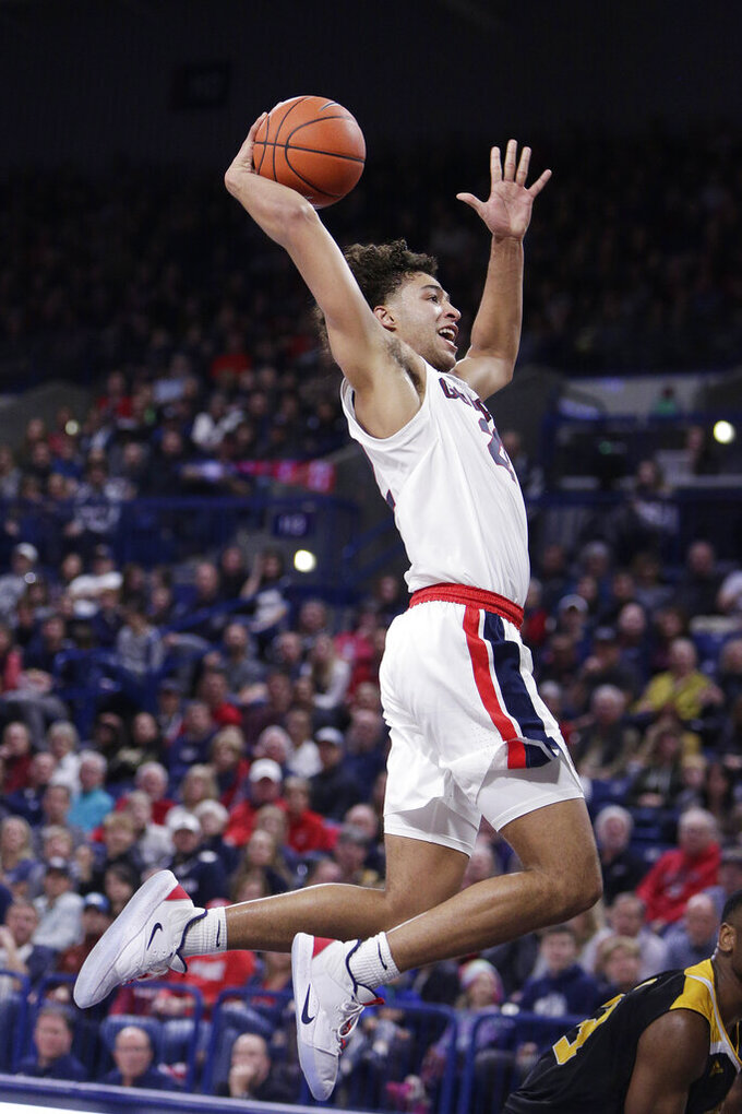 Gonzaga forward Anton Watson goes up for a dunk during the first half of the team's NCAA college basketball game against Arkansas-Pine Bluff in Spokane, Wash., Saturday, Nov. 9, 2019. (AP Photo/Young Kwak)