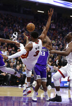 Miami Heat guard Dwyane Wade falls during the first quarter of the team's NBA basketball game against the Sacramento Kings on Friday, Feb. 8, 2019, in Sacramento, Calif. (AP Photo/Rich Pedroncelli)