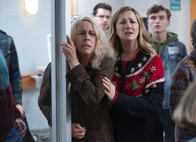 """This image released by Universal Pictures shows Jamie Lee Curtis and Judy Greer in """"Halloween Kills,"""" directed by David Gordon Green. (Ryan Green/Universal Pictures via AP)"""